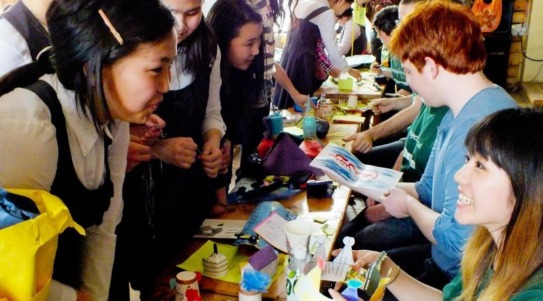 Projects Abroad volunteers prepare a crafts table during their teaching work experience in Mongolia